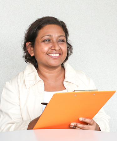 seeker: Professional working Indian female in office environment Stock Photo