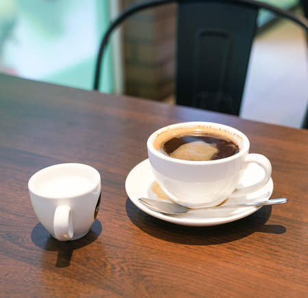 Long black coffee in a white cup
