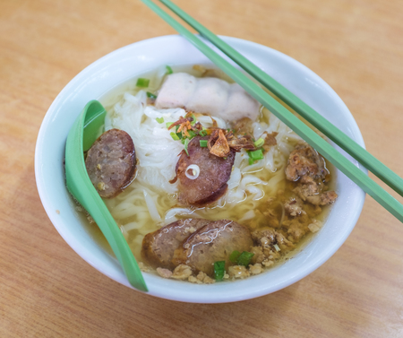 Pork noodles soup with chopsticks
