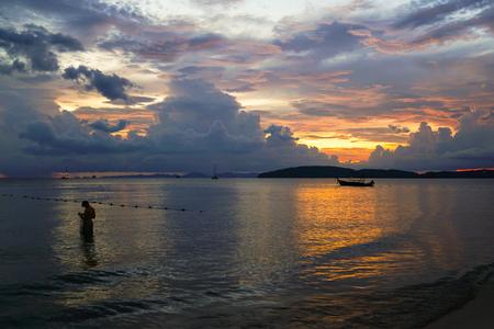 Beautiful sunset at Aonang beach at Krabi, Thailand