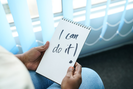 Concept of self-belief, motivation and positive attitude. I can do it, wrote on note pad Archivio Fotografico