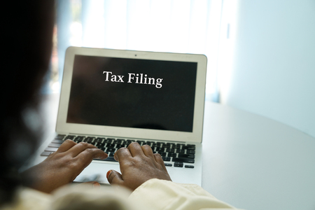 Tax filing : words appear on laptop screen as reminder