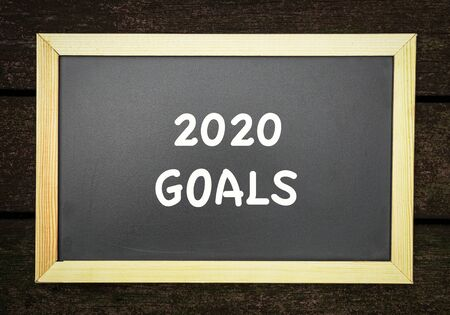 2020 new year goal, plans, resolutions setting. Text on black board.
