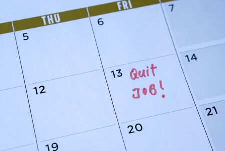 Quit job words written on table calendar with red marker. Employment or careers concept.