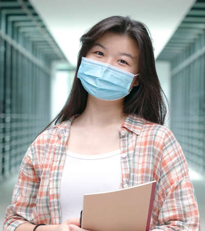 Portrait of an Asian woman wearing medical face mask