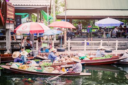 Tha Kha Floating Market, Samut Songkhram, Thailand - November 10, 2017 : The atmosphere of trading goods and food, on vintage boats at Tha Kha Floating Market
