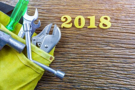 tools and 2018 messages on wood background.selective focus