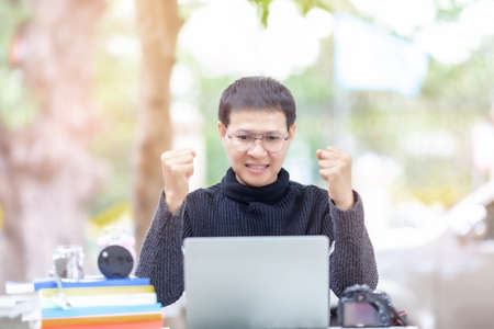Excited worker sitting at desk in working space use computer reading message looking at device screen received great unbelievable opportunity or reward. Motivated employee celebrating job promotion Stock fotó