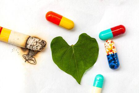 pills and cigarette, pills as cigarette smoke - Medical treatment