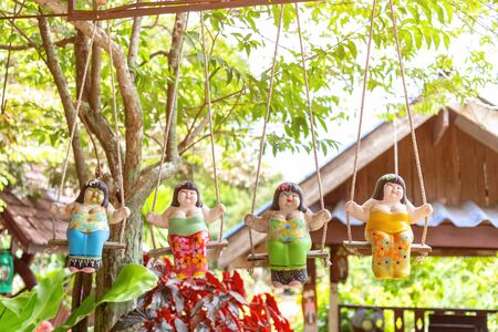 colorful Mobile hangs a cute girl doll ornaments Souvenirs are made of plaster and ceramic.