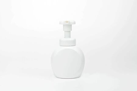 White cosmetic bottle dispenser pump with tube container from front angle isolated on white background.