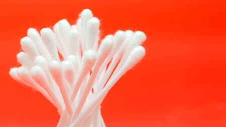 swabs cotton buds isolated on red background Banco de Imagens