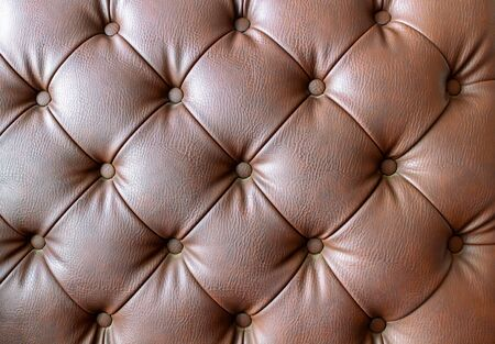 Detail of an old vintage brown couch with buttons Banco de Imagens