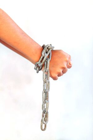 Hands are chained in chains isolated on white background Banco de Imagens