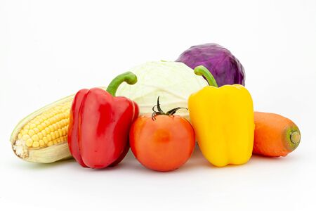 Fresh vegetables: cabbage, bell peppers, carrot, tomato,corn isolated on white background