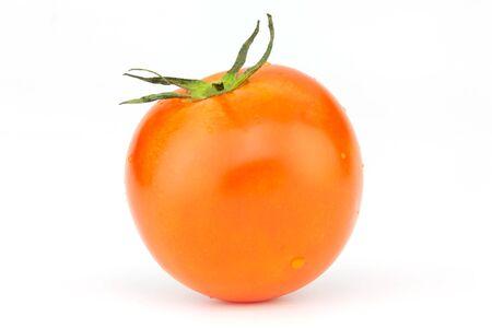 one fresh red tomato isolated on white background. Banco de Imagens
