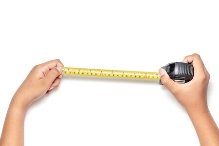 Close up view of man hand holding Tape measure. Human hands , isolated on white background measuring with construction roulette,  Engineer architecture.