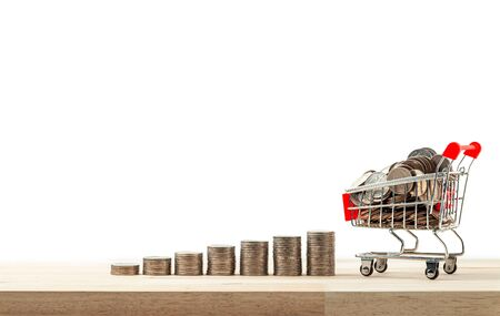 Business and financial, Shopping concept, Money stack step growing growth with shopping cart and trolley on a white background.