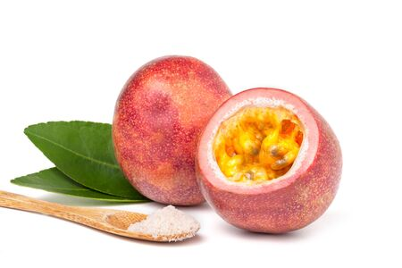 Isolated passionfruits. One and a half passion fruits (maracuya) isolated on white background