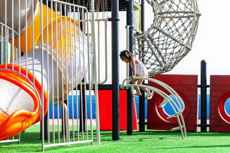 Rayong, Thailand: 20 November 2020 :a boy on the colorful playground on yard in the park. 新聞圖片