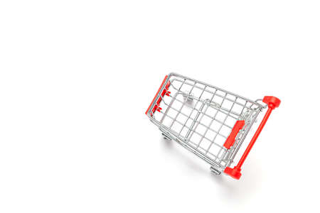 Empty red small shopping cart isolated on white background