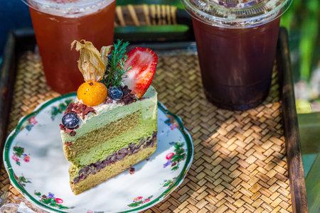 Vegetarian restaurant menu. Vegan cake with raw fruits and coffee.