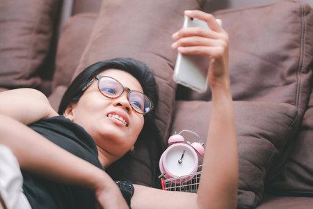 Thai young woman taking selfie  on brown background 版權商用圖片