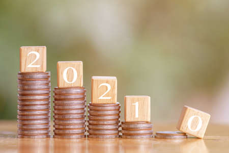 2021 and Coins stack. Pension fund, Passive income. Investment and retirement. Business investment growth concept. Risk management. Budget 2021. 版權商用圖片