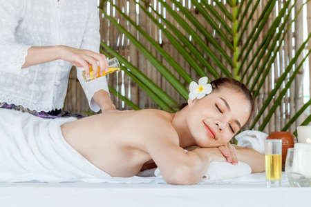Masseur doing massage on  woman body in the spa salon, Asian woman on massage bed relax and lifestyle, massage hands treatment. Beauty treatment concept. Stock fotó - 167302829