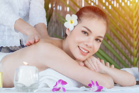 Masseur doing massage on  woman body in the spa salon, Asian woman on massage bed relax and lifestyle, massage hands treatment. Beauty treatment concept.