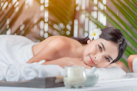 Relaxed asian woman lying in spa salon , waiting for massage Stock fotó