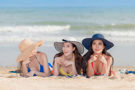 A picture of a group of women having fun on the beach. Summer holidays, travel, vacation concept. Copy space.