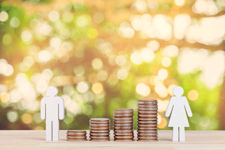 Miniature people: Group of couple and father, Mother,  standing near stack of coins on wooden background, saving planning, financial, insurance, business growth and family concept.
