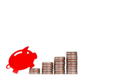 red piggy bank with coins . Concept of growth in savings.