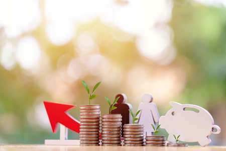 wooden  Piggy  in close-up and leaf on coins stack in the natural background, Saving ideas and investment budget, Business saving money concept, Copy space Stock fotó