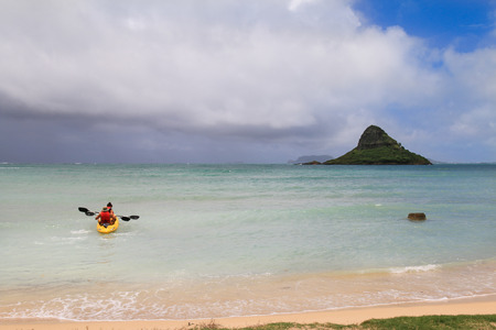 oahu: Canoeing family at Mokolii island formerly known as Chinamans Hat