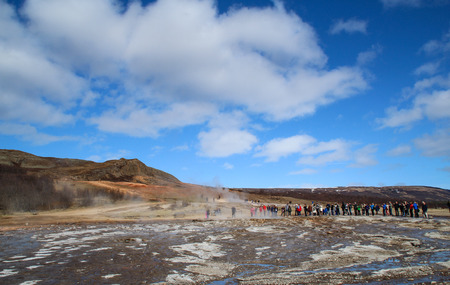 tourist waiting for geysir explosion