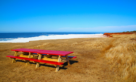 red picnic table in Cavendish Beach