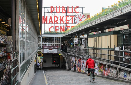 city fish market sign: Seattle, United States - Mar 31 2014: The Famous Pike Place Public Market, opened August 17, 1907, and is one of the oldest continually operated public farmers markets in the United States.