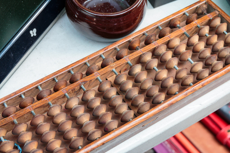 Old wooden abacus on the table