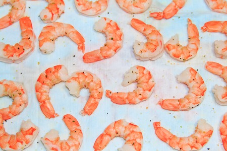 Cooked refined shrimps on white background