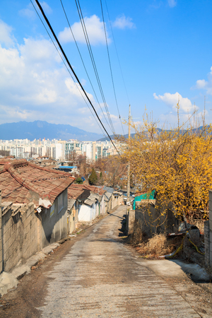gutted: View of the last poor hillside village called Baeksa Village(104 town or 104 village) in Seoul, Korea. Stock Photo