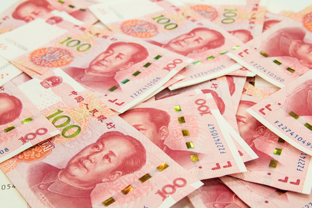 Background consisting of many Chinese 100 RMB Yuan notes Stock Photo