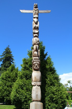 A totem wood pole in stanley park, Vancouver, Canada