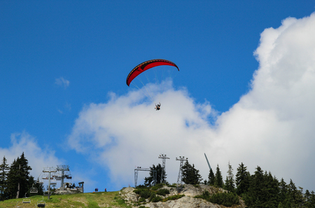 Paragliding launching from the Grouse Mountain in Vancouver, Canada