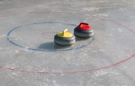 Curling stone on the ice