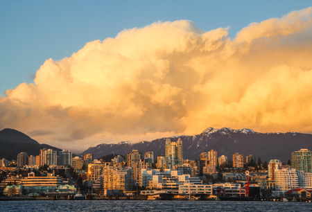 View of North Vancouver with cumulus clouds Stock Photo