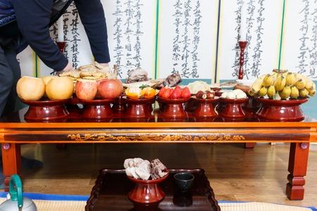 Seoul, Korea - Feb 5 2019: Table setting with various fruits and foods for Korean traditional Holiday (Chuseok, Seollal)