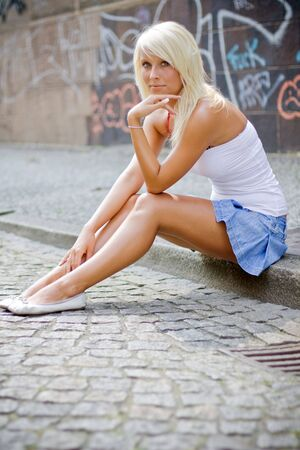 beautiful blond girl in urban area  photo