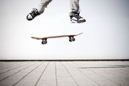skateboard shoes: skater making an olli with his skateboard